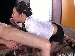 Amazingly hot Japanese stewardess stands on her knees and gives perfect blowjob. She makes guy cum fast because she is real blowjob expert.