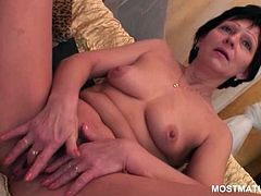 Brunette perky titted mature having a taste of her own sweet pussy
