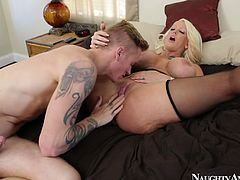 Messy blond curvy milf in black stockings and lingerie kneels down to oral fuck a tattooed dude before he pays her back by eating her nasty slit in perverse sex clip by Naughty America.