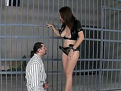 Something really incredible is happening right now! Hot brunette Eloa Lombard is getting through the bars and unlocks the long-haired criminal and makes him taste her coochie.