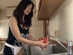 See the hot and intense Japanese brunette milf Manami Komukai as she masturbates her hairy clam in the kitchen before giving her man a hell of a blowjob. Then she's ready to be banged balls deep into kingdom come.