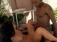Slim black haired babe India Summer with pierced belly button and dark heavy make up gets her trimmed cunny boned deep by black dude and rides on his sausage like crazy