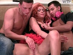 Spoiled Russian red-haired whore in cheap red lingerie and stockings widens her legs in order to welcome rapacious rubbing from two horny wankers in steamy group sex video by WTF Pass.