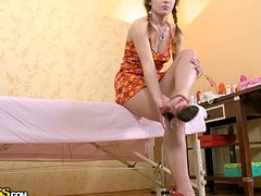 Young Russian chic comes to the massagist appointment. She gets her slender body stroked gently using warm oil in sensual WTF Pass sex video.