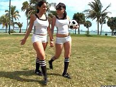 Sophia and Summer Bailey are tow curvy brunettes in sexy white uniform. They play football and then pull down their hotpants to show their perfect big butts in the field. Watch big ass honeys strip in the open air.