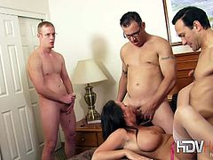 This naughty brunette has always wondered what it would be like to have more than one cock and gets more than she bargained for in this homemade amateur gangbang action.