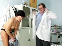 Svelte brunette granny gets her tits mauled intensively by kinky doctor before she bends in order to welcome a thermometer into her ruined beaver.