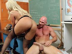 Insatiable bald fucker cannot get away from a jaw dropping busty slut while fucking her in missionary style before she stands on her knees to mouth fuck hard cock.