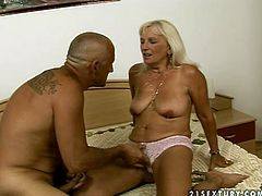 Slutty mature blonde Mamie has fun with some bald dude. She lets him finger her pussy and then welcomes his dick in her depths.