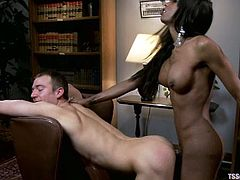 Alex Shoots is getting naughty with ebony shemale Natassia Dream in an office. They have oral sex and then the ladyboy destroys the man's tight butt.