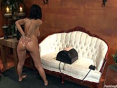 Halie James wants the sex machine to work out her pussy. Watch this busty brunette getting nailed by the machine while she rubs the vibrator in her wet hole.