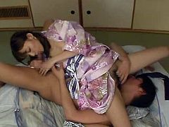 Charming Japanese woman and her man caress each other passionately and get horny. Then they bang in missionary position and the slut can't help but moan loudly in pleasure.