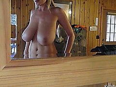 One way for Kelly Madison to relieve cabin fever is to make things fun and that means taking her top off to expose her twin peaks and let her husbands big cock fuck her