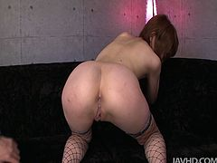 She is trashy trollop wearing sassy fishnet stockings and white color high heels. She keeps her legs wide letting perverted guy play with her snatch.