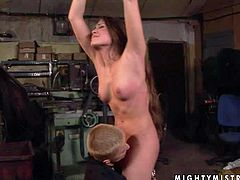Long haired brunette slim babe with small boobies and tight ass gets tied up with hands above the head and gets disciplined and tortured by short haired blonde bitch in garage