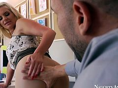Bootyful blondie Phoenix Marie gives a head in office