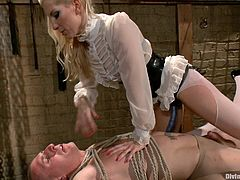 Watch this crazy blonde dominatrix bitch tie up her victim, whip him into shape and then fuck his cute little ass with a huge strapon sex toy.