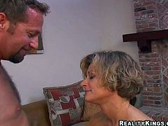 Sexy slim mature brunette milf with small tits and fit body in short white skirt and undies has fun with her filthy neighbor and takes on his meaty pecker in living room