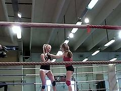 Sporty babes Leyla Black and White Angel are fighting on a ring. But when the fight is over, they continue their exercise off ring, hugging and kissing each other.
