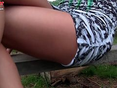 Dirty blonde likes posing in outdoor while gently fingering her shaved twat