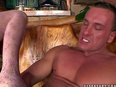 Skillful brunette bombshell Szilvia Lauren with natural boobs in stockings gives mid blowing foot job to tanned turned on stud with perfectly shaped muscled body in living room in close up