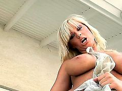 In order to get off hard, all blonde busty Sheila Grant needs to do is use her middle finger and use it as a toy. She is doing that on a nice sunny day outdoors.