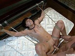 Cute dark-haired girl Katie Summers is playing dirty games with James Deen indoors. She lets the man tie her up and then loves the way he pounds her sweet pussy.
