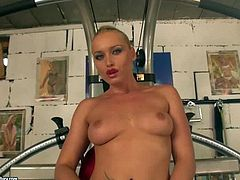 Tattooed sporty blonde Kathia Nobili does exercises naked and shows her naughty parts. She is proud of her firm round ass and neat pussy. Watch hot bodied blonde pose naked for your viewing pleasure.