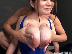 Kinky Japanese girl with huge boobs gets oiled up. Later on she gives a blowjob and gets her hairy pussy torn up.