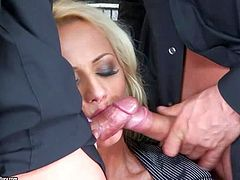 Smoking hot business blonde with delicious ass and great hunger for cock in black outfit and stockings seduces two tattooed muscled studs and has wild threesome with them on couch on a lazy afternoon