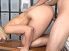 Blonde cheerleader fucks a dude in the locker room and gives a big smile with cum on her face.