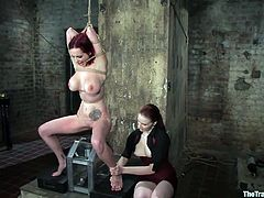 Take a look at this bondage scene where a redhead's mistress and master please her wet pussy with brutal pounding and torturous games.