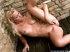 Cute blonde Sophie Moone is getting naughty in the bathroom. She takes a shower and pleases herself with tender pussy fingering.