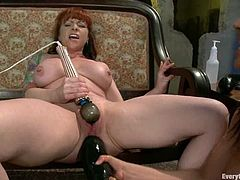 Brunette and redhead chicks make an amazing show. The redhead chick gets her ass toyed with huge dildo. After that she also gets fisted.