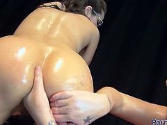 Kinkydirtybitch and Mandy Cinn are all oiled up and ready for hardcore lesbian fisting. Watch this hot brunette taking it up in her cunt!
