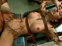 Hot chick lie on a medical chair being tied up and gagged. Doctor fixes clothespins to her body and then fucks her deep.