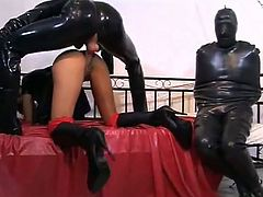 Dressed in latex from head to toe, this dominant male fucks his ebony's pussy hard and applies different punishments.