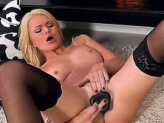 Oh, what a cute bitch Alexis Ford is! Enjoy looking at how she is staying in black stockings only demonstrating body before taking big black dildo  pushing it into snatch.