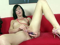 See this horny brunette taking off her clothes to play with her pink pussy in this solo scene where she'll give you one hell of a boner.