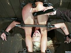 There's some fucked up stuff going on in this BDSM video where the sexy blonde Kaylee Hilton goes through extreme bondage and toying.