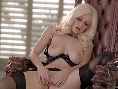 Beautiful blonde Danielle Trixie in black lingerie shows off her big natural melons and lovely ass as she rubs her pink pussy with her fingers in front of the camera. Watch stunning buxom blonde play with herself.