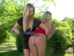 Danielle Maye and Lexi Lowe are tow charing curvy blondes that loves spanking. Charming babe in red short dress gets her perfect bubble ass spanked by lovely lesbian domina in the garden.