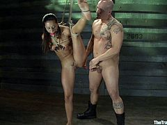 This is the kind of gagging and deepthroat porn all kinky BDSM lovers enjoy watching. She is tied up and left completely helpless, there is nothing she can do.