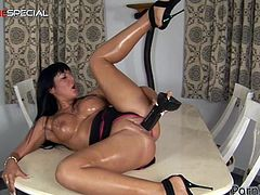 The hugely breasted brunette Angelica Heart will take a huge dildo in her pussy in this solo show in the kitchen.