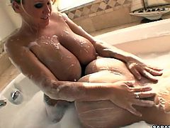 Sexy lesbian babes are stimulating one another during sexy warm bath session