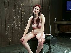Iona Grace is the naughty redhead featured in this extreme bondage BDSM porn video where she's also toyed and spanked a bit.