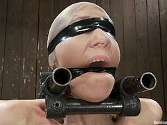 Horny Alia Janine stands on her knees on the floor. She gets bonded with special devices and gets toyed.