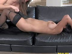 Malena Morgan and Megan Salinas are two incredibly beautiful lesbian brunettes. Sexy babe in black stockings gets her perfect tits touched and her sweet pussy licked by her friend on the couch.