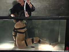 Brunette girl gets tied up and then toyed. After that the guy pours hot wax on her body and puts this bitch in an aquarium.