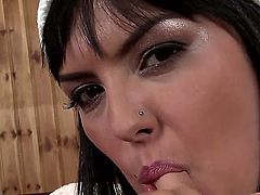 Seducive brunette bombshell Jasmine Black plays with her huge melons on the camera